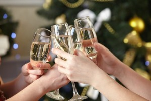 43954218 - glasses of champagne in female hands on christmas party