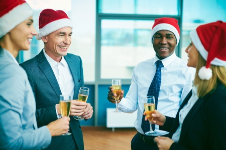 46663039 - modern office workers in santa caps celebrating christmas after work