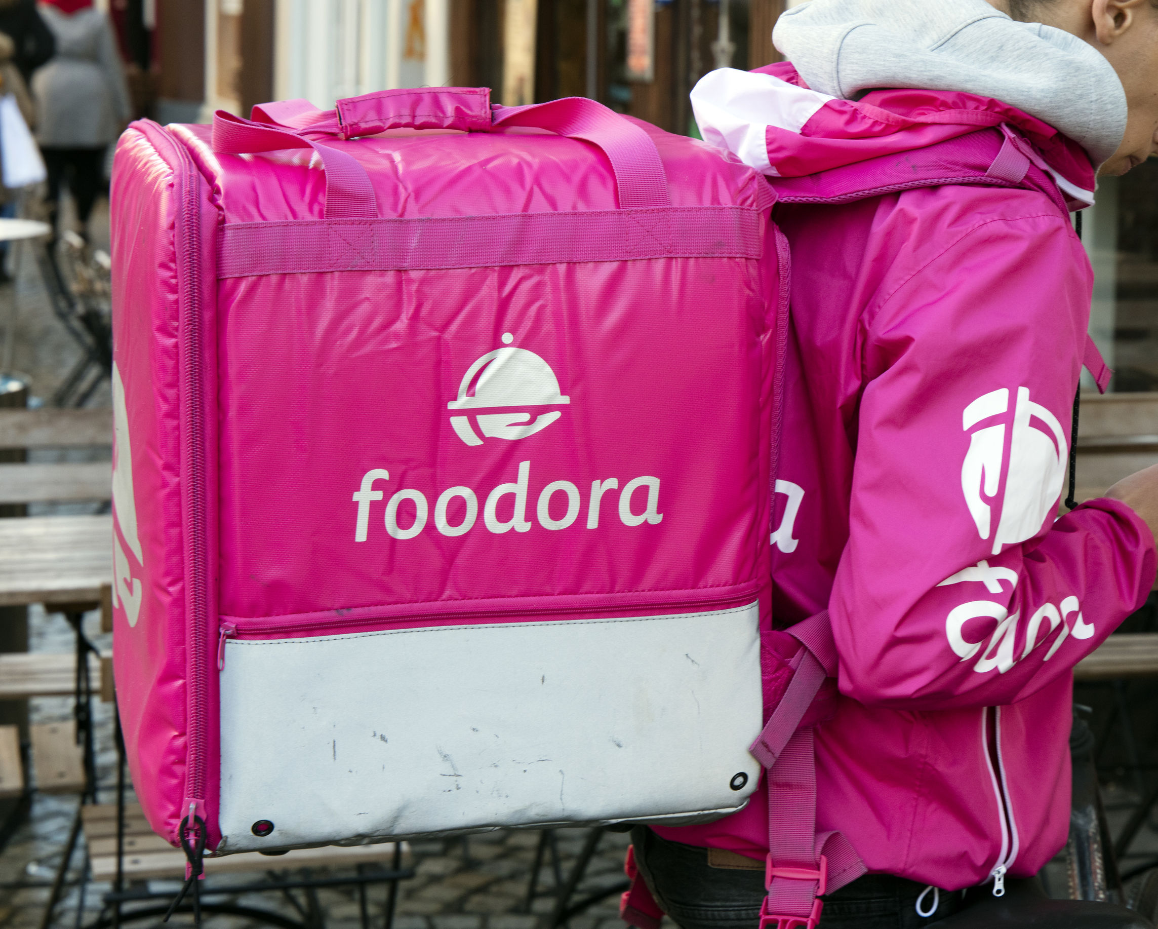 Foodora courier in a street in Amsterdam